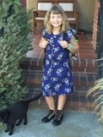 My daughter in the dress she made