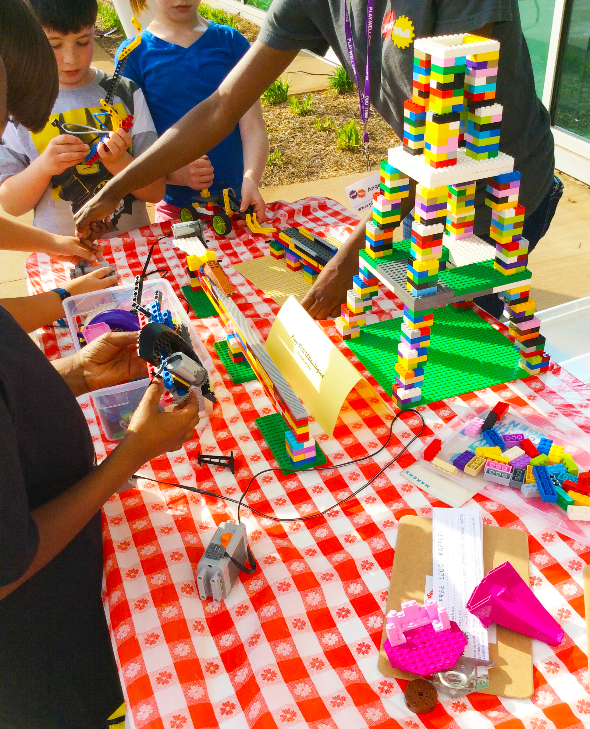 Students build with Legos during Drew Charters Designorama event.