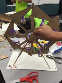 A cardboard Ferris Wheel a member made at ReCreate.