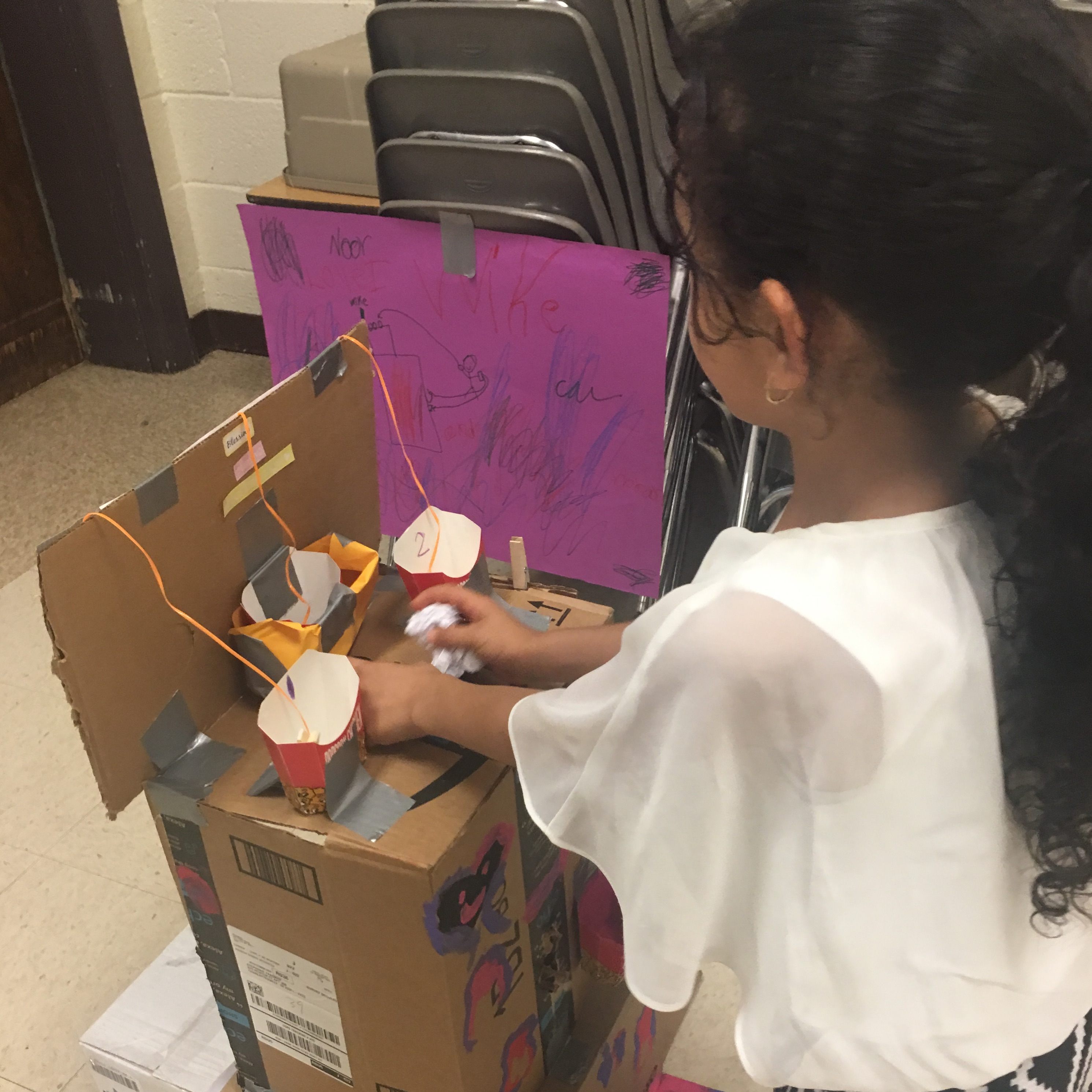 A young girl demonstrates her cardboard project. Image courtesy of Pam Moran.