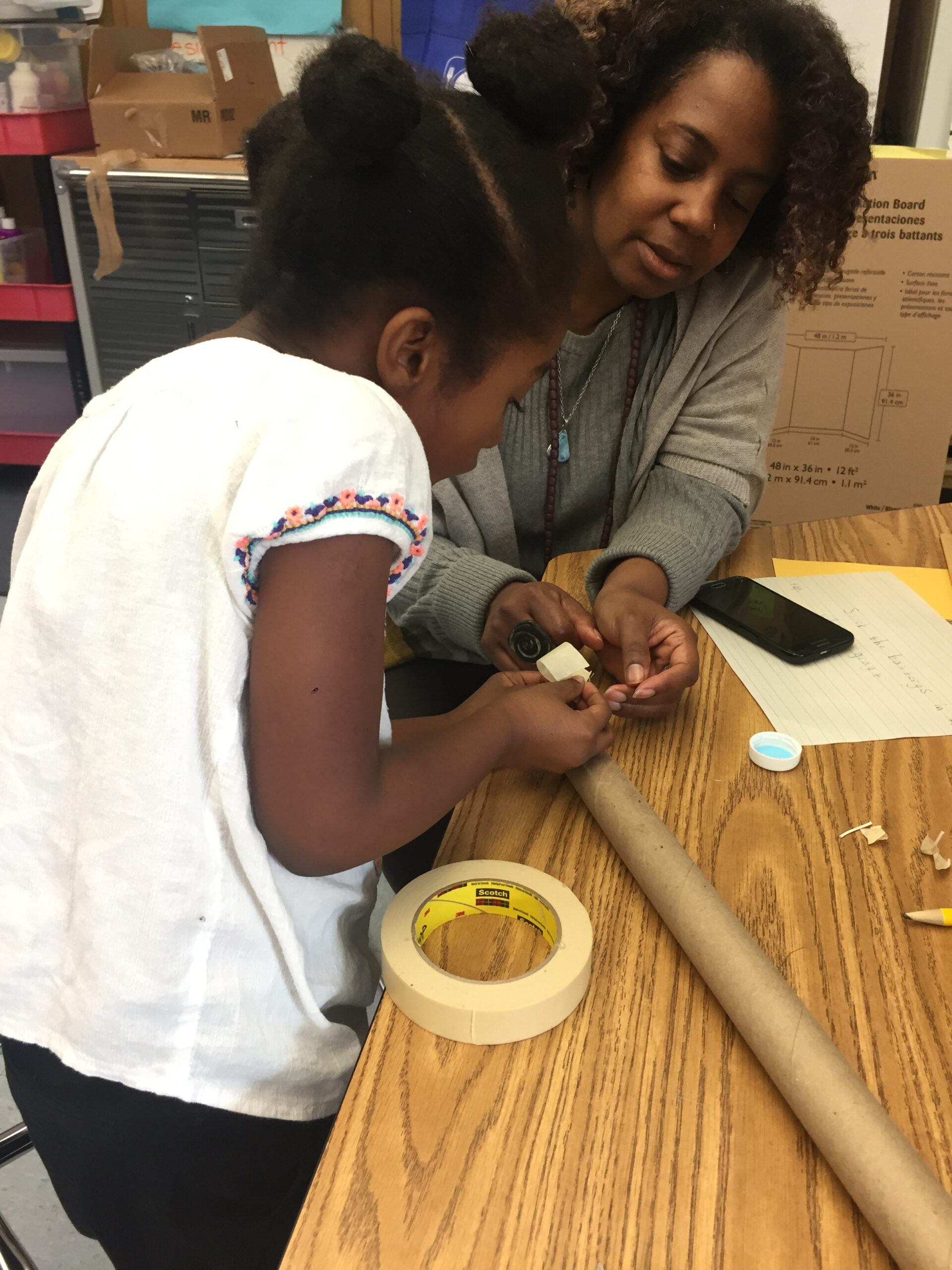 Paula works with a first grader on her self-designed project in Grass Valley Elementary's Wonder Workshop.