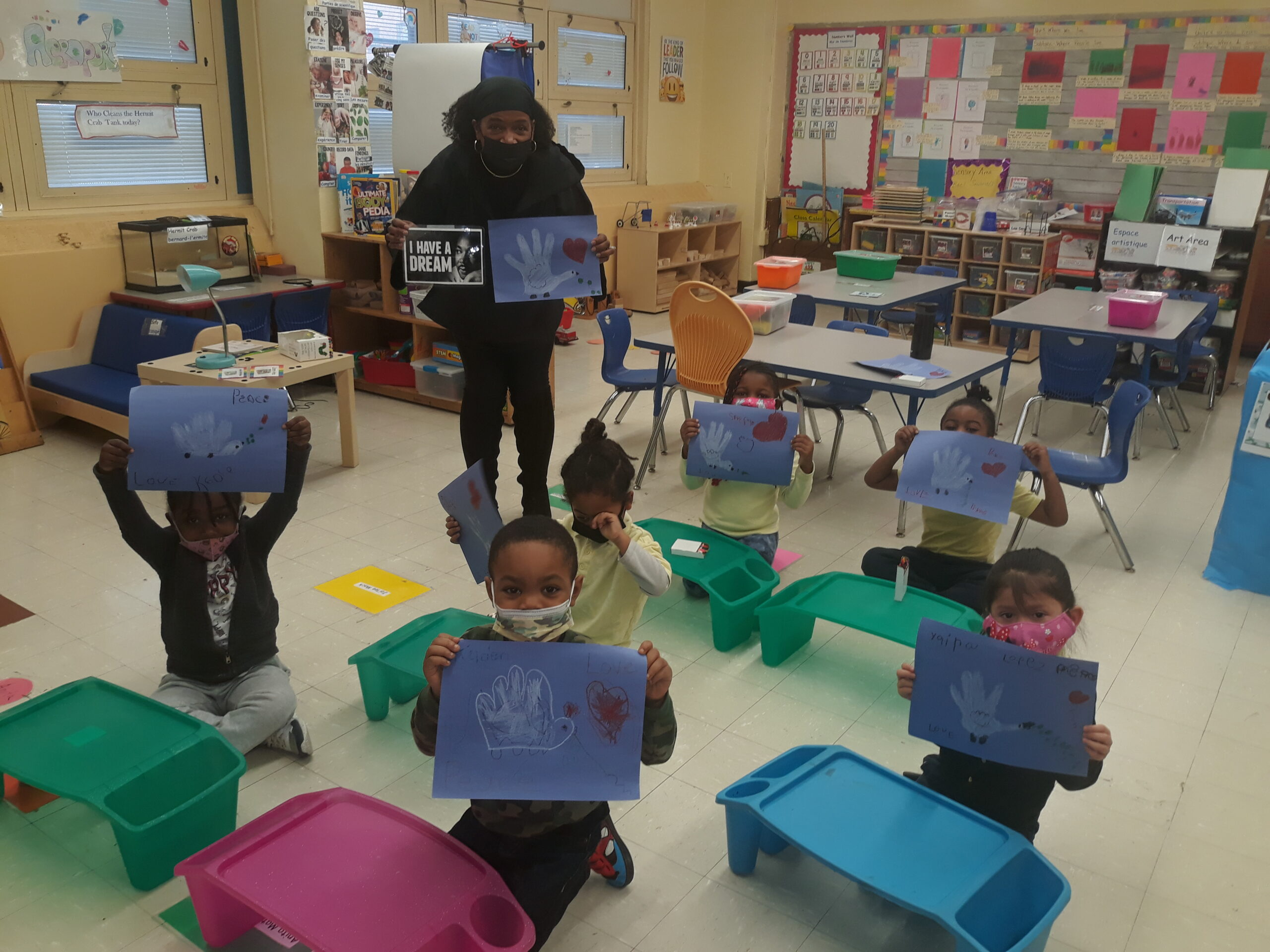 A photo of Ms. White and Kindergarten students honoring the legacy of Dr. Martin Luther King Jr.